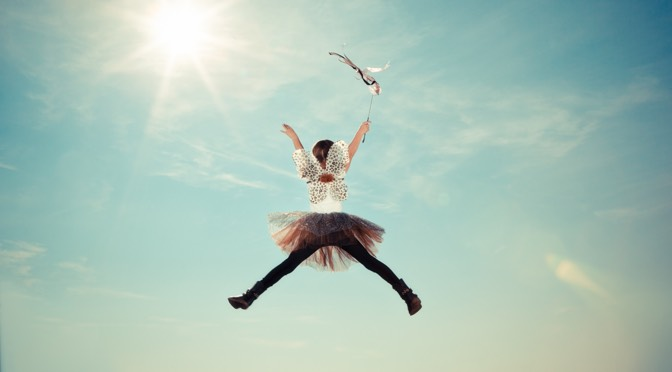 girl jumping with excitement
